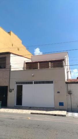Casa com 6 dormitórios à venda, 300 m² por R$ 750.000 - Monte Castelo - Fortaleza/CE