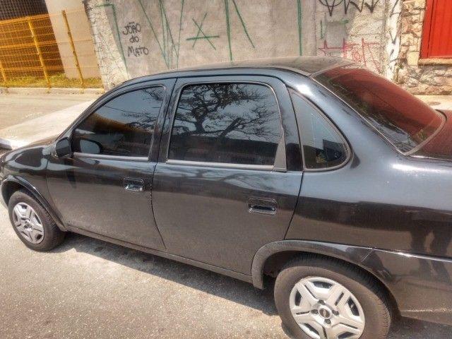 carro em ótimo estado e sem dividas , muito bom e econômico , banco de couro - Foto 2