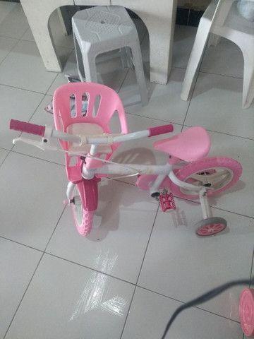Bicicleta nova e uma motoca usada - Foto 2