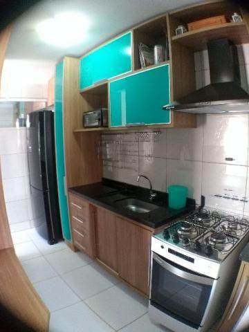 Apartamento de 2 quartos(1 suíte) com móveis projetados em todos os cômodos e quintal