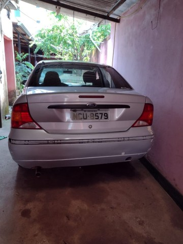 Focus sedan 2005 valor 11.000 aceita carro menor vor - Foto 4