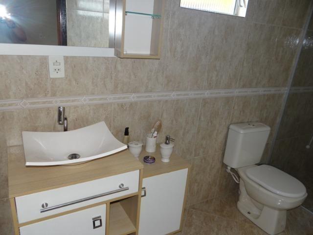 Lindo sobrado, 04 dormitórios, 03 banheiros, terreno todo murado - Foto 9