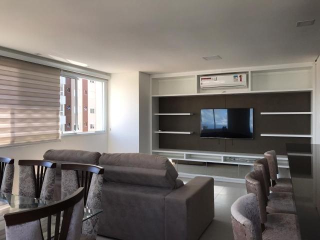 Apartamento em Torres de 3 dormitórios mobiliado