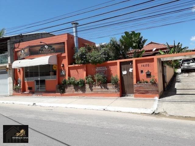 Ótimo Casa próximo do centro, com 03 quartos sendo 01 suíte + loja comercial - Foto 2