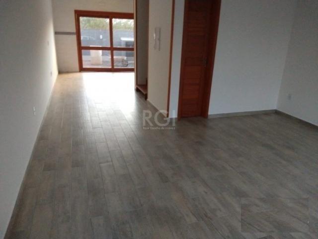 Casa à venda com 3 dormitórios em Guarujá, Porto alegre cod:BT9928