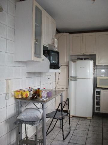 Apartamento central,três dormitórios e garagem