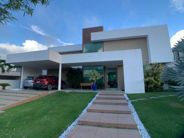 Casa linda e aconchegante com 4 suítes e localizada no Condomínio Laguna.