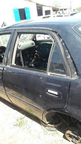 Porta traseira esquerda toyota corolla xei 2000