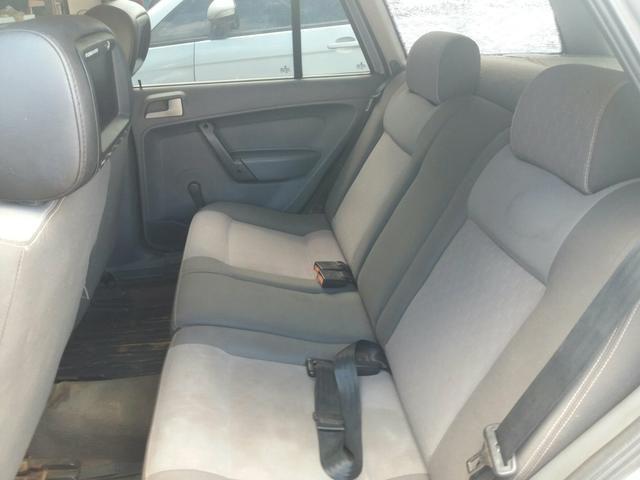 Troco em corsa sedan de menor valor com volta - Foto 4