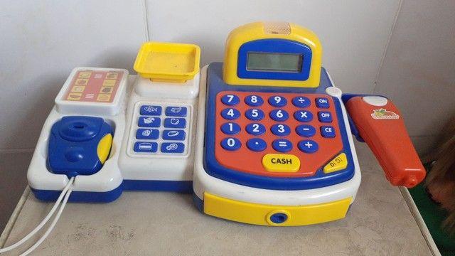 Bonecas e caixa registradora, 100 reais as 5 bonecas e a caixa 100