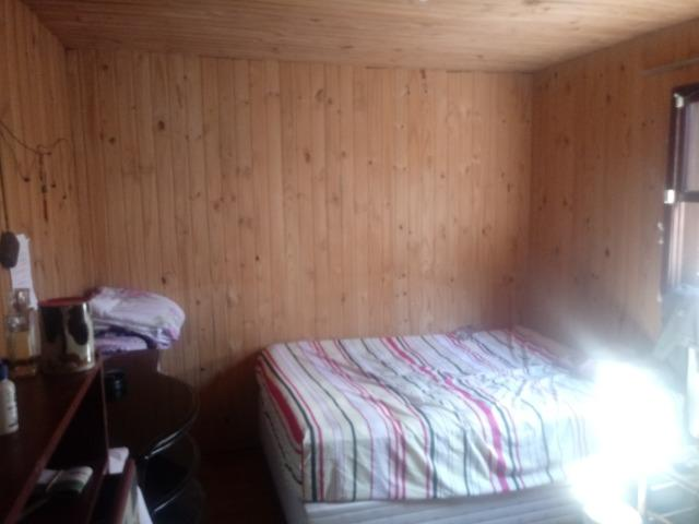 Venda de terreno com casa de madeira - Foto 9