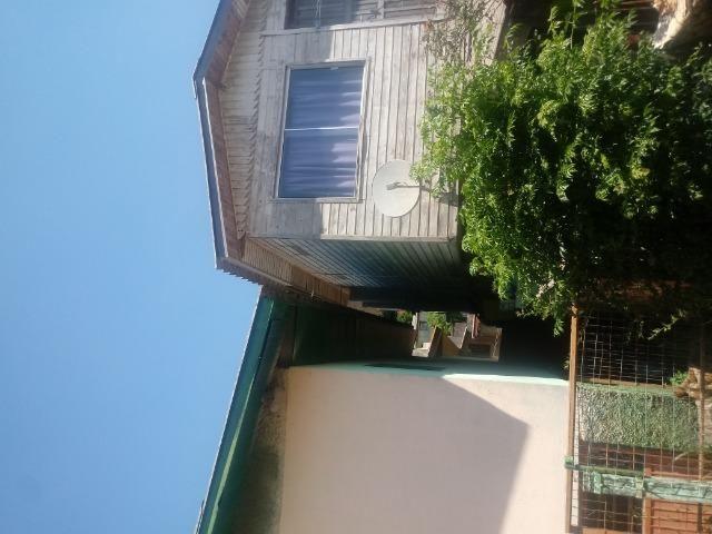 Venda de terreno com casa de madeira - Foto 13