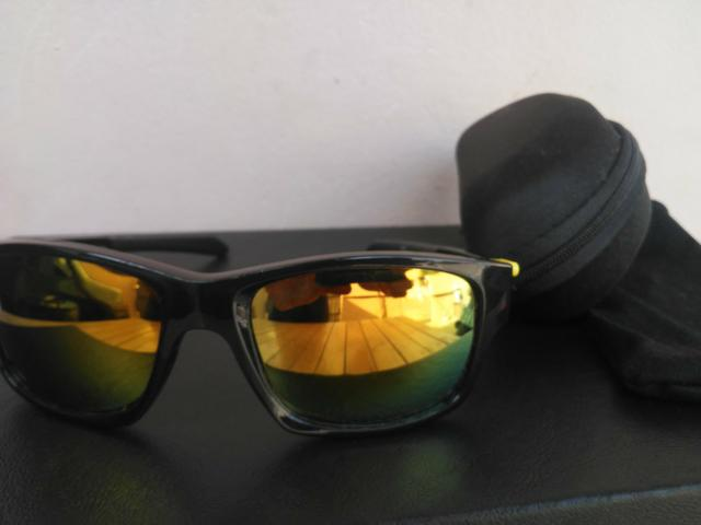 Óculos Oakley espelhado lente polarizada
