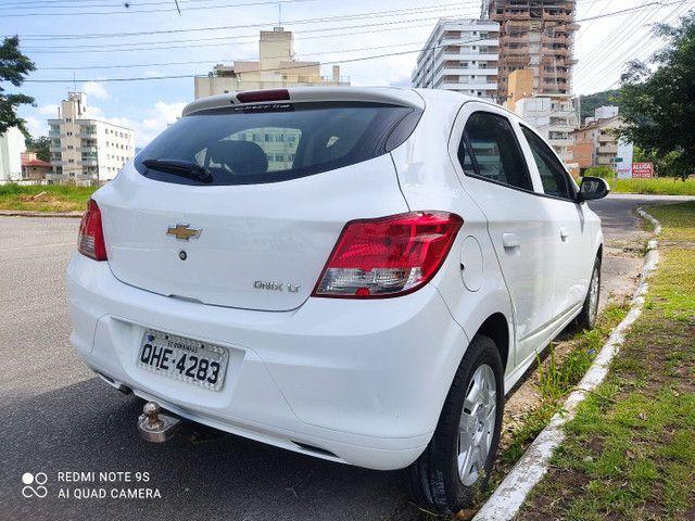 ONIX LT 1.0 2015 IPVA pago Aceito trocas - Foto 5