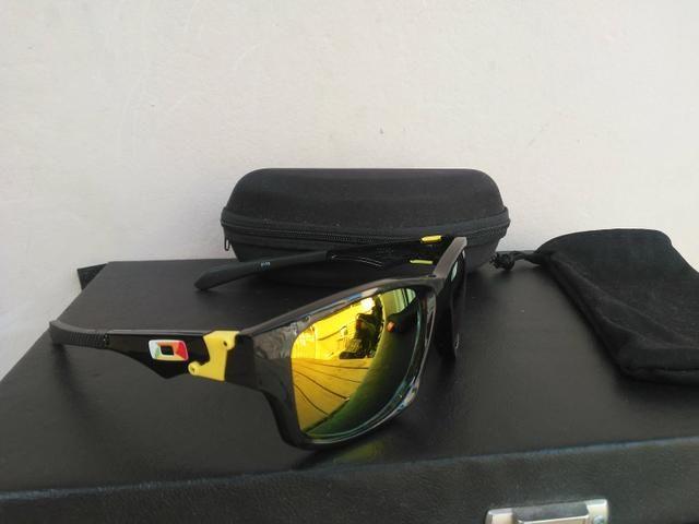 Óculos Oakley espelhado lente polarizada - Foto 2