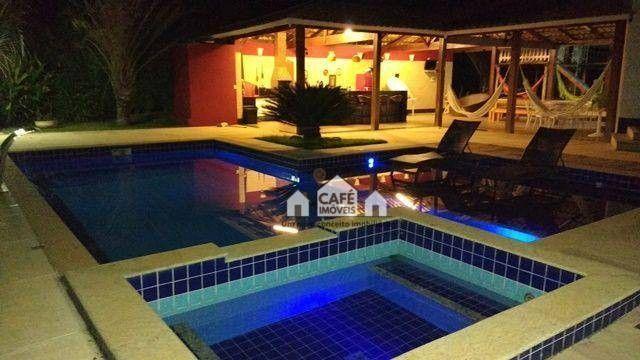 Casa com 4 dormitórios à venda, 540 m² por R$ 2.500.000,00 - Condomínio Bougainville - Lag
