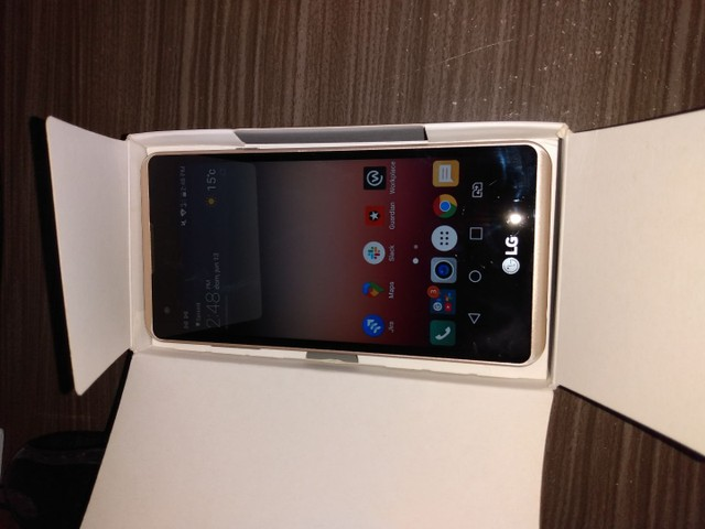 Celular LG k220 com caixa. Ac prop. - Foto 2