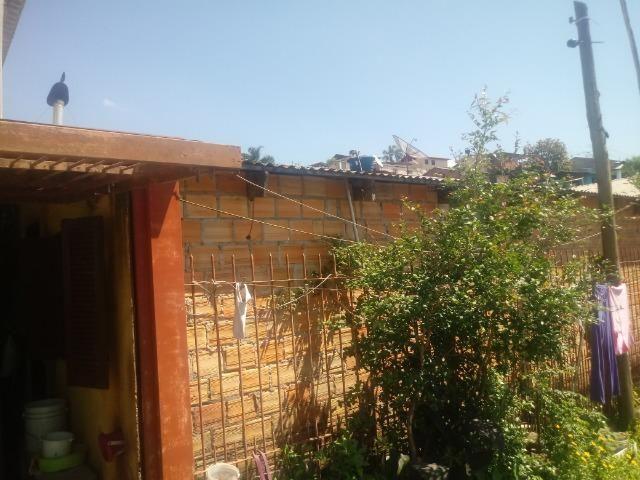 Venda de terreno com casa de madeira - Foto 14