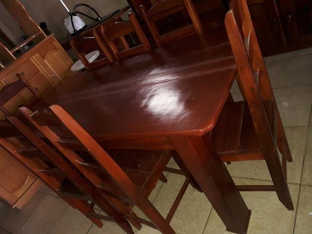Mesa 8 cadeira 800 armário 550 jogo de área 350 entrego