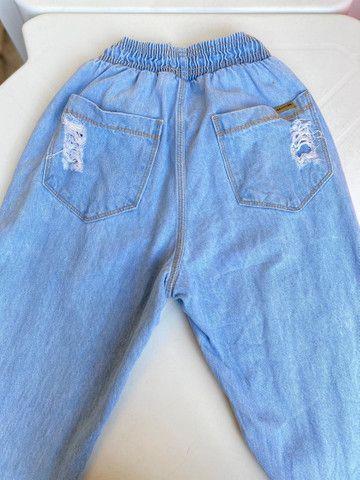Calça tecido jeans bem larguinha