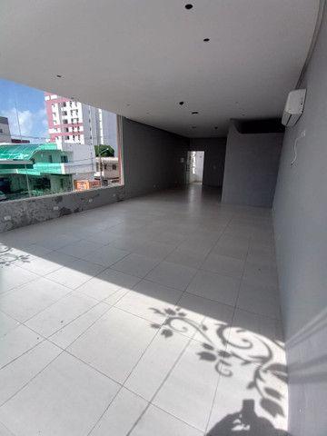Sala comercial na galeria térrea de frente para  avenida. - Foto 14