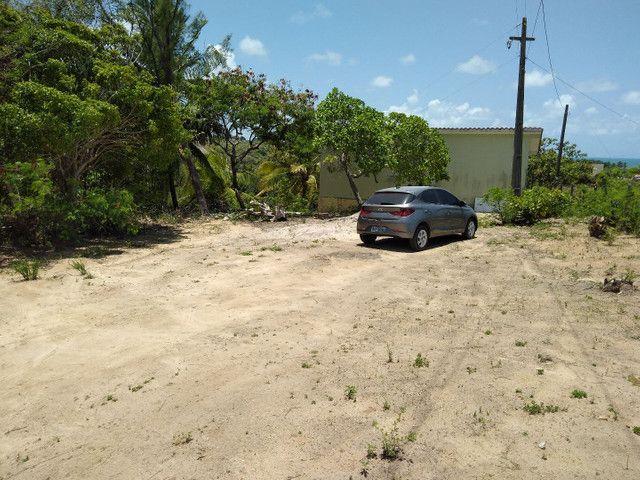 Vendas de um terreno com casa na praia Bela na paraiba
