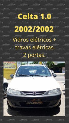 GM Celta 1.0 com vidros e travas elétricas. Carro bom e barato. Confira! - Foto 11