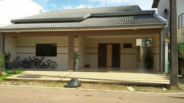 Casa com 3 suites e piscina