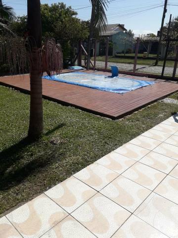 Casa com piscina em Capão