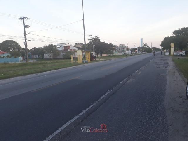 Terreno murado e aterrado de frete para a rodovia - Foto 2