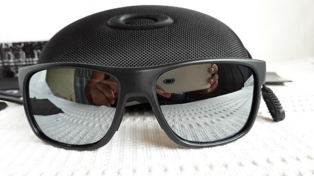 2058cb6dbb06b Óculos Oakley Crossrange XL Preto Cinza Polarizado - Novo e Importado