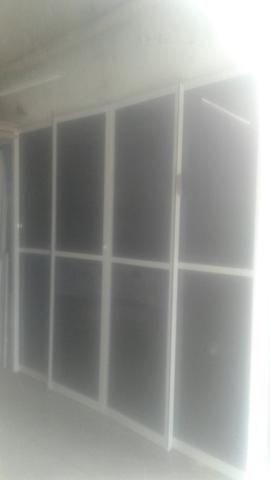 Porta de aluminio com vidro e pelicula semi nova tel.998604555