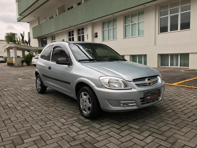 Chevrolet Celta com Ar-condicionado - Entrada + 390 por mês - Foto 3