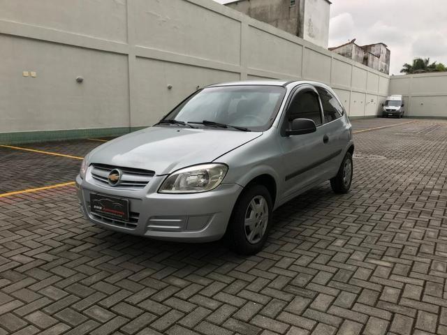 Chevrolet Celta com Ar-condicionado - Entrada + 390 por mês