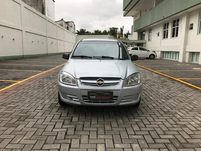Chevrolet Celta com Ar-condicionado - Entrada + 390 por mês - Foto 2