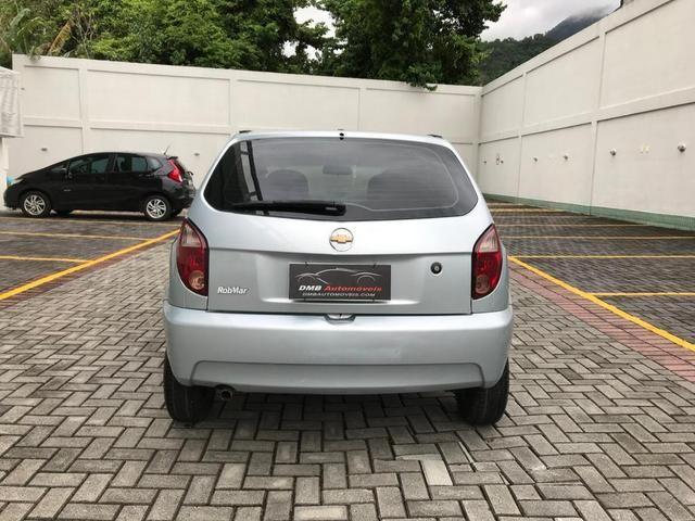 Chevrolet Celta com Ar-condicionado - Entrada + 390 por mês - Foto 5