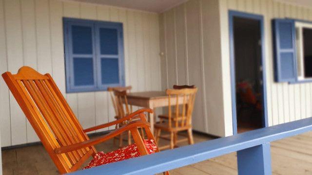 Casa pé na areia  locação de temporada com 4 dormitórios no Perequê - Cód. 73AT
