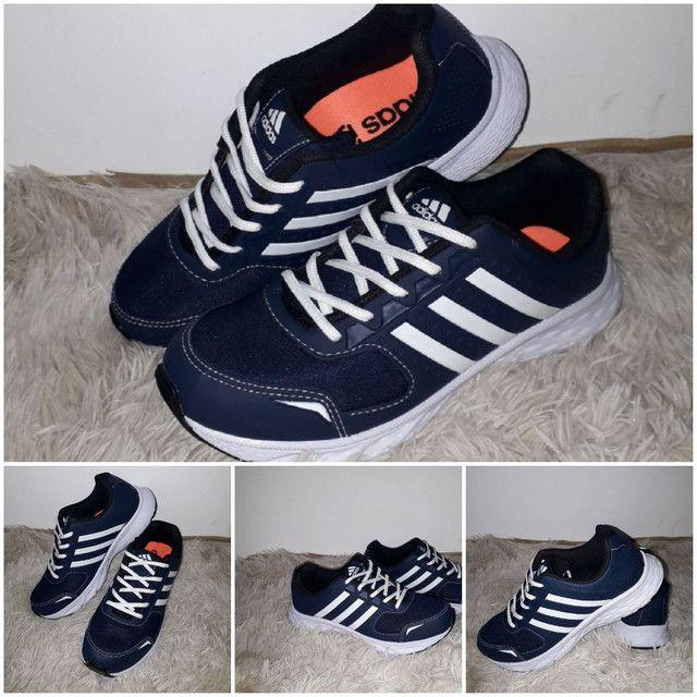 9 8 6 0 0 - 1 0 2 1 * Tênis Adidas novo na caixa cor azul