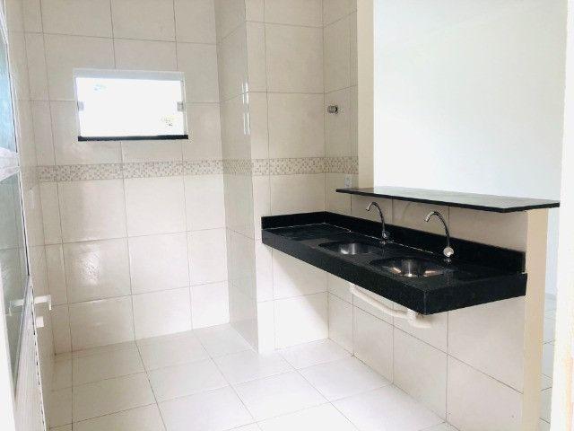 WS casa nova com 3 quartos,2 banheiros,coz.americana,quintal com otima localização - Foto 7
