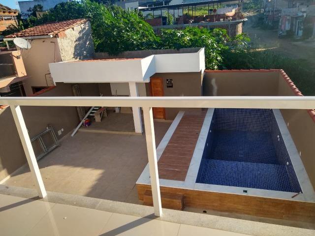 Linda casa com piscina e duas vagas de garagem - Foto 19