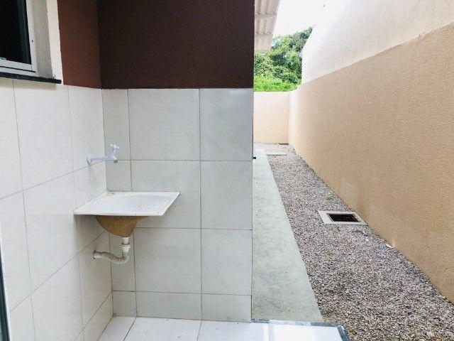 WS casa nova com 3 quartos,2 banheiros,coz.americana,quintal com otima localização - Foto 13