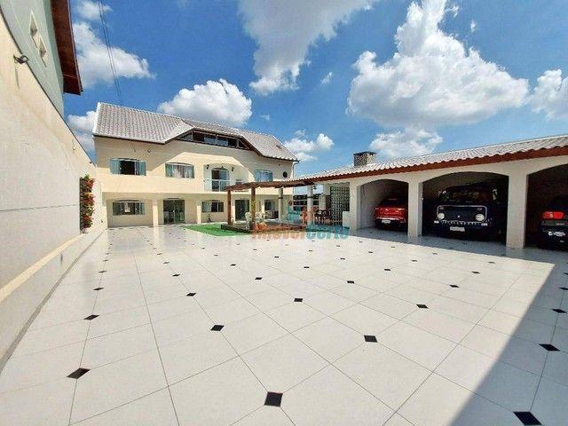 Casa com 5 dormitórios sendo 2 suíte à venda, 500 m² por R$ 1.485.000 - Campo Comprido - C
