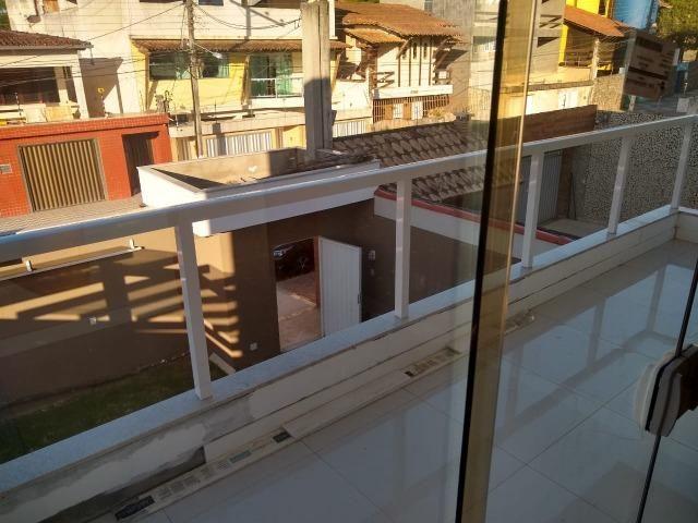 Linda casa com piscina e duas vagas de garagem - Foto 10