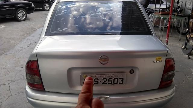 Chevrolet corsa sedã super 1.0, cor prata, completo, flex - Foto 6