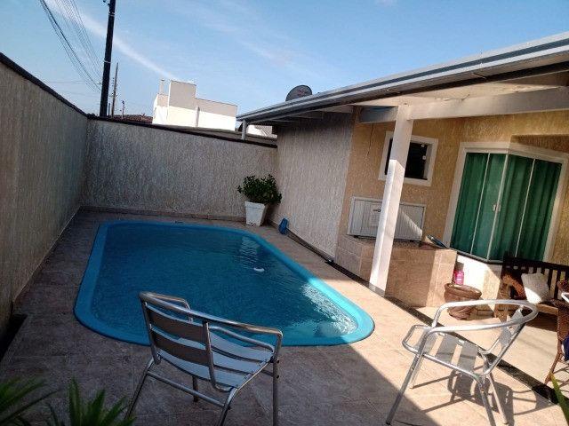 Casa com 3 dormitórios e piscina para temporada no Perequê em Porto Belo - Cód. 88AT