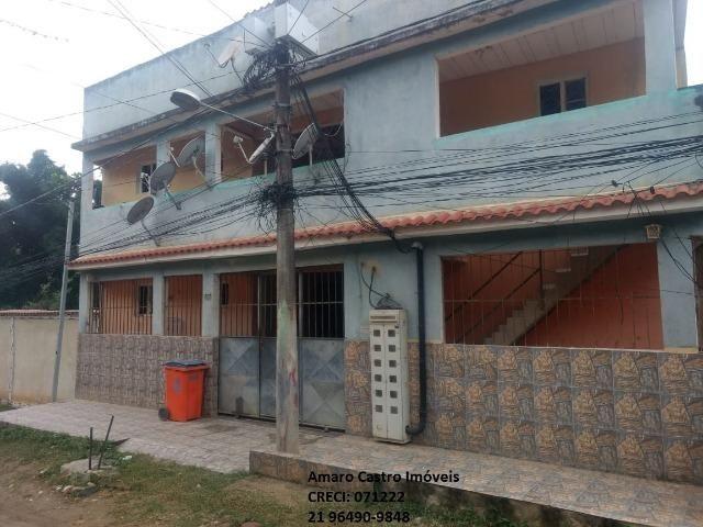 COD 168 - Prédio com 10 casas 1 e 2 qts - em frente Centro Comercial de Cabuçu - NI