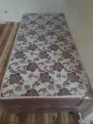 Vendo cama de solteiro nova no plástico 3 meses de uso