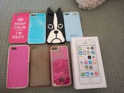 iPhone 5s na caixa com capinhas