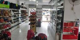 Passa se duas loja de calçados e acessórios