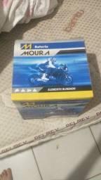 Título do anúncio: Bateria nova para moto comprei errado 5 meses de garantia